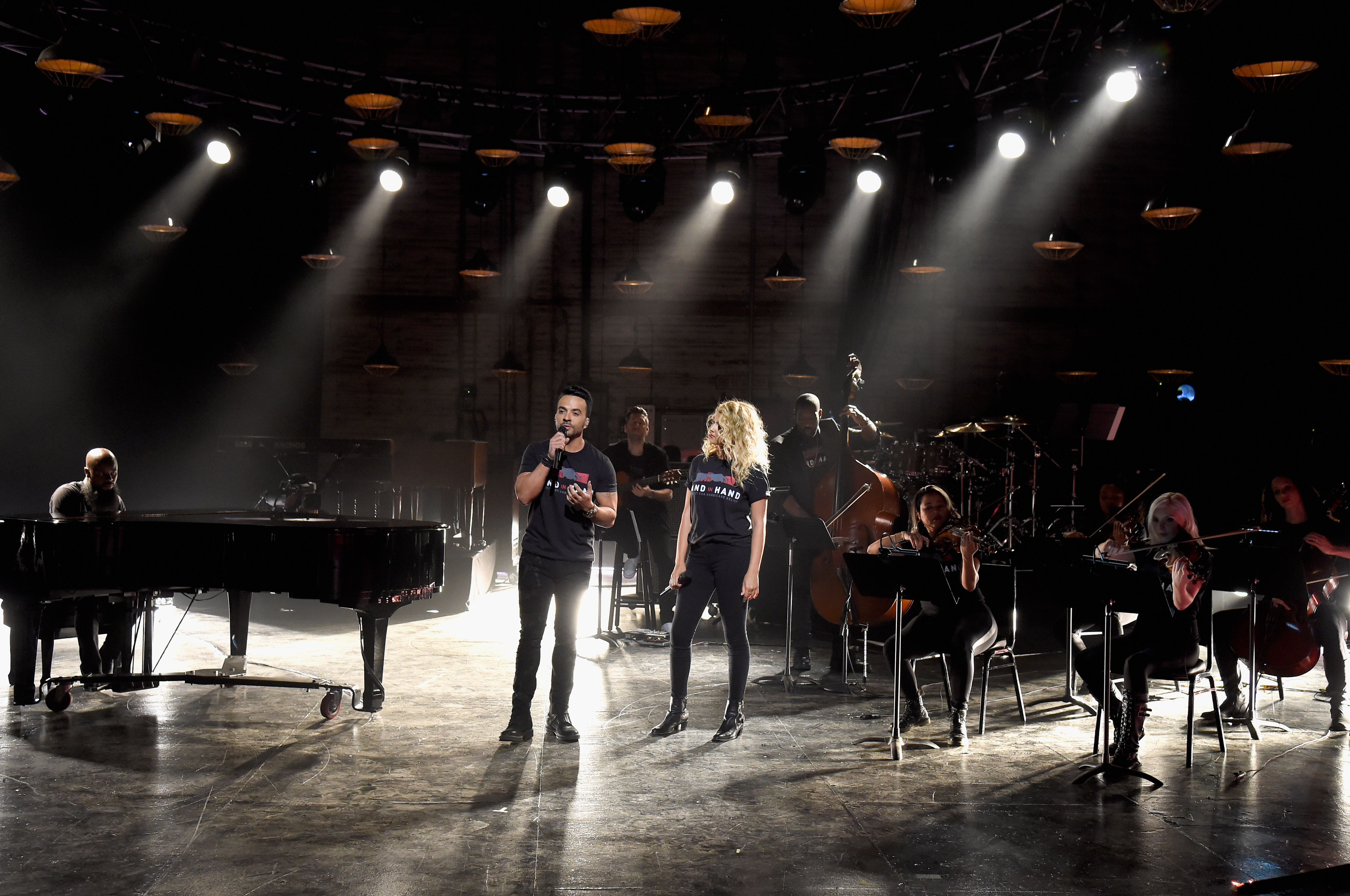 "<div class=""meta image-caption""><div class=""origin-logo origin-image none""><span>none</span></div><span class=""caption-text"">Luis Fonsi and Tori Kelly perform during Hand in Hand: A Benefit for Hurricane Relief at Universal Studios AMC on September 12, 2017 in Universal City, California. (Kevin Mazur/Hand in Hand/Getty Images)</span></div>"
