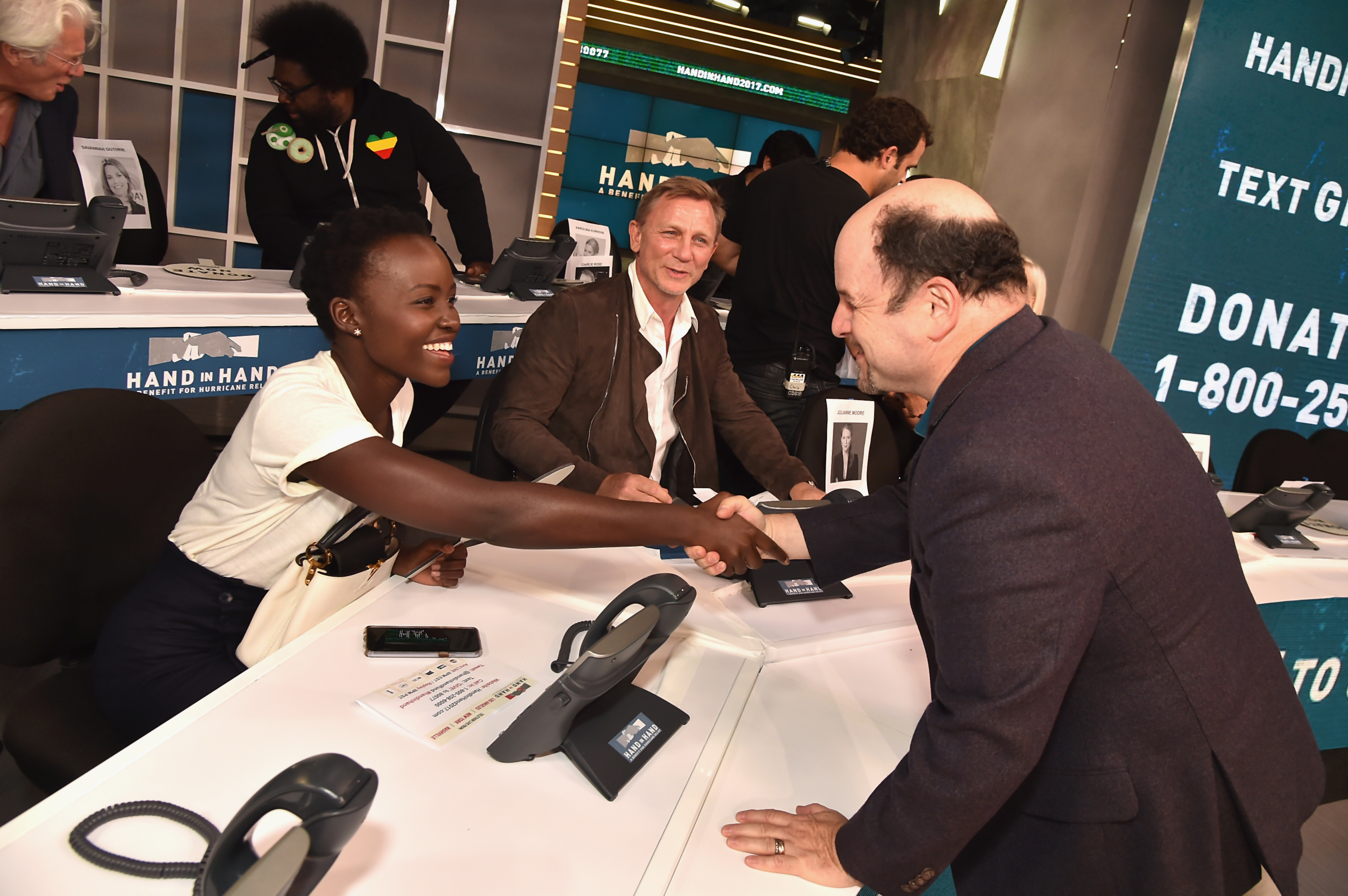 "<div class=""meta image-caption""><div class=""origin-logo origin-image none""><span>none</span></div><span class=""caption-text"">Lupita Nyong'o, Daniel Craig and Jason Alexander  attend the Hand in Hand benefit at ABC News' Good Morning America Times Square Studio on Sept. 12 in New York City. (Theo Wargo/Hand in Hand/Getty Images)</span></div>"