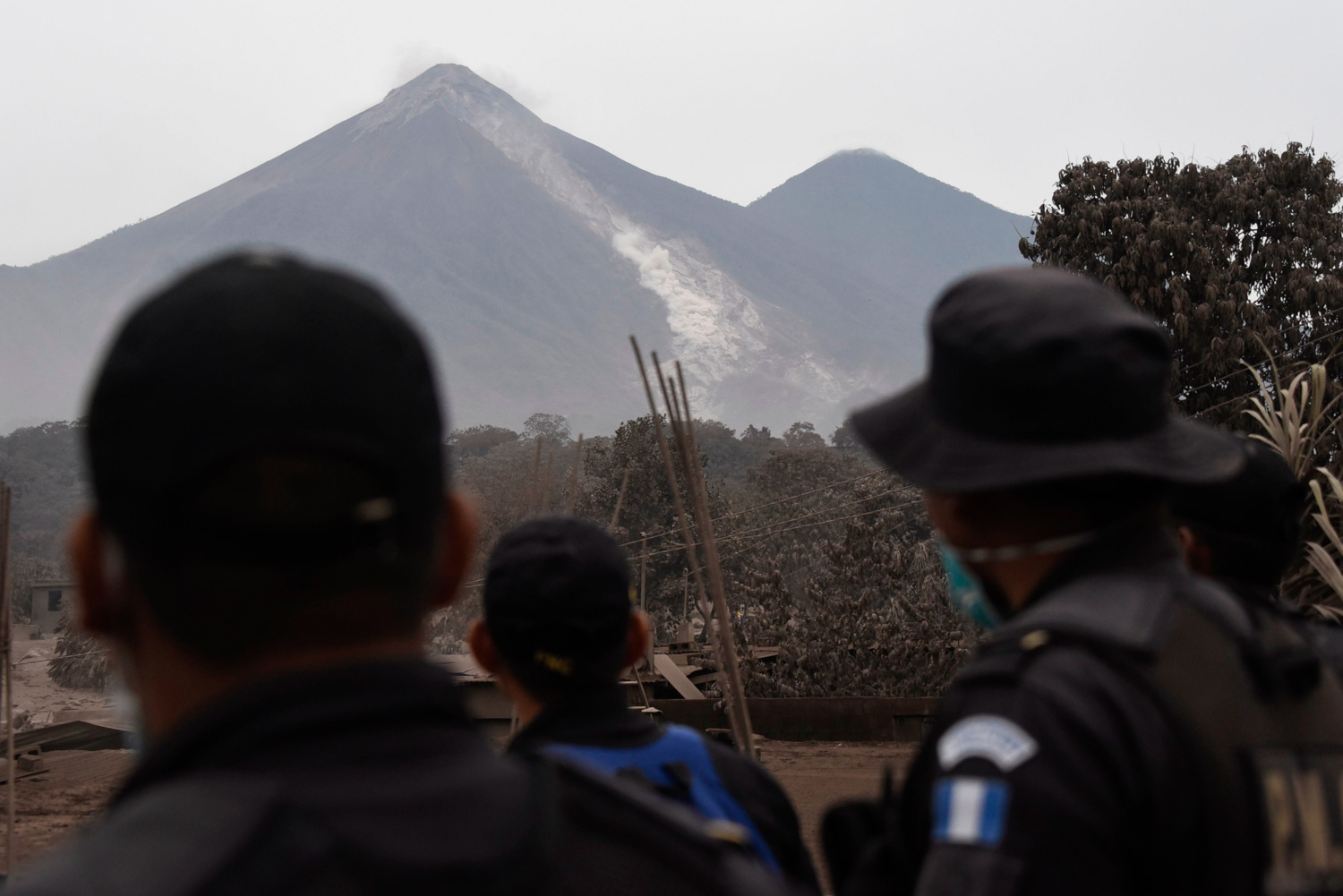 <div class='meta'><div class='origin-logo' data-origin='none'></div><span class='caption-text' data-credit='JOHAN ORDONEZ/AFP/Getty Images'>Police officers look at the Fuego Volcano from San Miguel Los Lotes, a village in Escuintla Department, about 35 km southwest of Guatemala City, on June 4, a day after an eruption.</span></div>