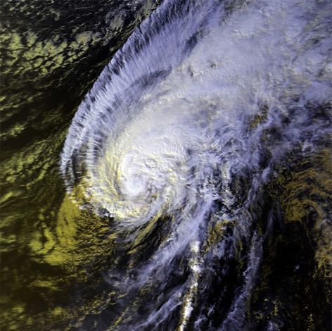 Satellite imagery of Hurricane Iwa in 1982. The storm created to $250 million dollars in damage. <span class=meta>Wikipedia Commons</span>