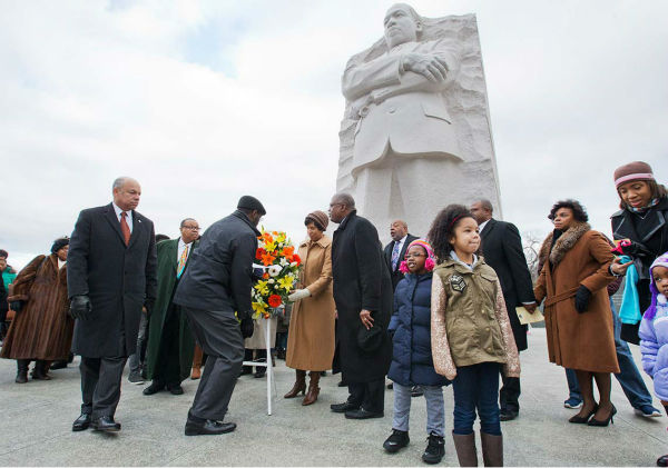 """<div class=""""meta image-caption""""><div class=""""origin-logo origin-image """"><span></span></div><span class=""""caption-text"""">Homeland Security Secretary Jeh Johnson, left, participates in a wreath laying ceremony at the Martin Luther King, Jr. Memorial, on MLK Day, Monday, Jan. 19, 2015, in Washington.  (AP Photo/Jacquelyn Martin)</span></div>"""