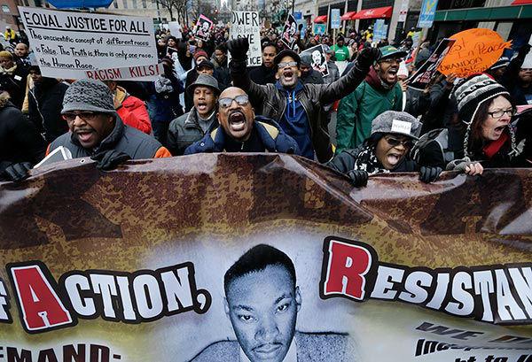 "<div class=""meta image-caption""><div class=""origin-logo origin-image ""><span></span></div><span class=""caption-text"">Dwayne Gilbert, center, of Philadelphia, marches to honor Rev. Martin Luther King Jr., Monday, Jan. 19, 2015, in Philadelphia.  (AP Photo/Mel Evans)</span></div>"