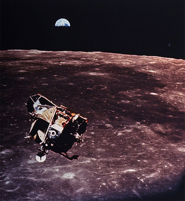 A serene photo of the Lunar Module hovering over the moon with the Earth in the distance. <span class=meta></span>