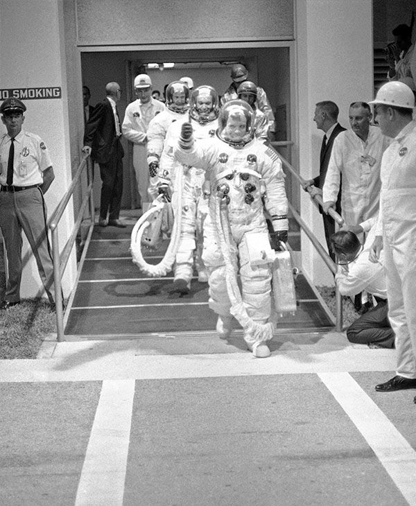 <div class='meta'><div class='origin-logo' data-origin='none'></div><span class='caption-text' data-credit='AP'>The Apollo 11 astronauts walk the route to the Saturn Five rocket at Cape Kennedy.</span></div>