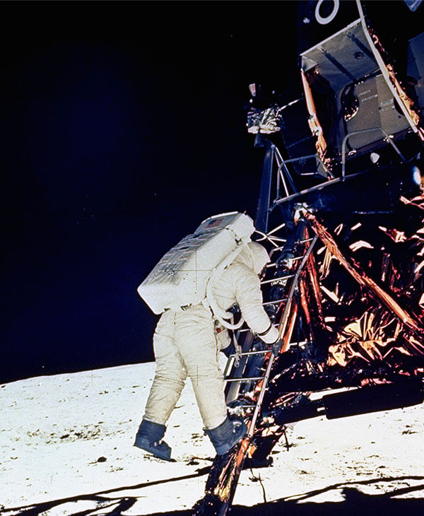 <div class='meta'><div class='origin-logo' data-origin='none'></div><span class='caption-text' data-credit='AP'>Neil Armstrong begins to climb down from the Lunar Module to walk on the moon.</span></div>