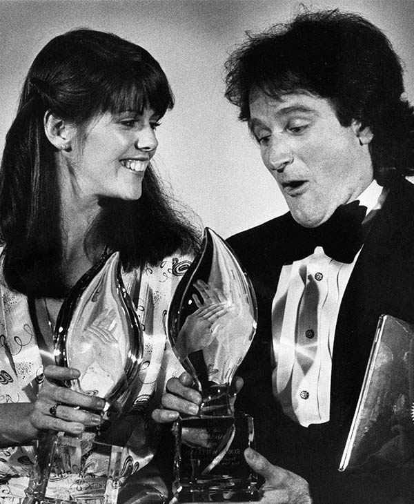 <div class='meta'><div class='origin-logo' data-origin='~ORIGIN~'></div><span class='caption-text' data-credit='Photo/AP'>Williams after winning a People's Choice Award for his role in &#34;Mork and Mindy&#34; in March 1979.</span></div>
