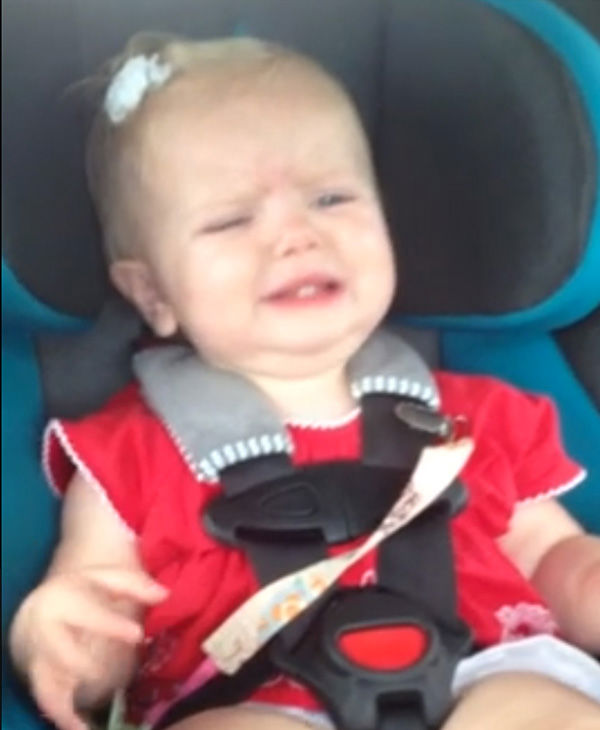 At the beginning of the video, the baby is clearly agitated. <span class=meta>(Eva Baker &#47; YouTube)</span>