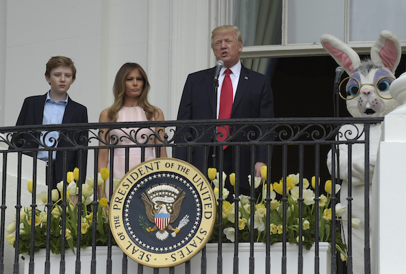 <div class='meta'><div class='origin-logo' data-origin='Creative Content'></div><span class='caption-text' data-credit='AP Photo/Susan Walsh'>President Donald Trump, standing with his son Barron Trump, first lady Melania Trump, and Easter Bunny, address the crowd at the annual White House Easter Egg Roll.</span></div>
