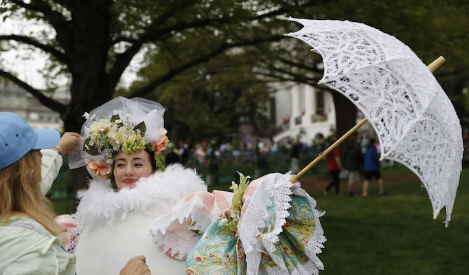 <div class='meta'><div class='origin-logo' data-origin='Creative Content'></div><span class='caption-text' data-credit='AP Photo/Carolyn Kaster'>&#34;Eggitha&#34; from the Virginia Egg Council has her Easter bonnet straightened during the White House Easter Egg Roll on the South Lawn of the White House in Washington, Monday, April,</span></div>