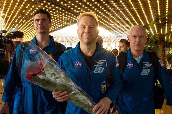 "<div class=""meta image-caption""><div class=""origin-logo origin-image none""><span>none</span></div><span class=""caption-text"">Expedition 47 astronaut Tim Kopra of NASA, center, arrives at the Karaganda Airport with Yuri Malenchenko of Roscosmos, and Tim Peake of the European Space Agency. (NASA/Bill Ingalls)</span></div>"