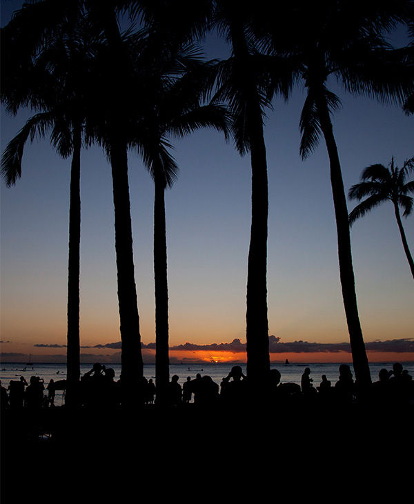 "<div class=""meta ""><span class=""caption-text "">The sun set on New Year's Eve on Waikiki Beach. (Carolyn Kaster / AP)</span></div>"