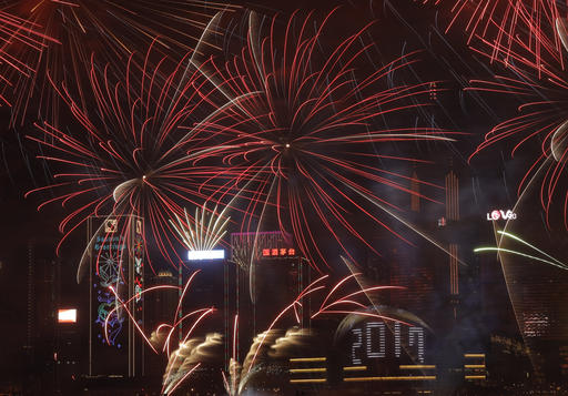 <div class='meta'><div class='origin-logo' data-origin='AP'></div><span class='caption-text' data-credit='AP Photo/Vincent Yu'>Fireworks explode over Victoria Harbour to celebrate the New Year's Eve in Hong Kong, early Sunday, Jan. 1, 2017.</span></div>