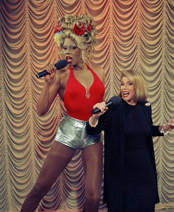"<div class=""meta ""><span class=""caption-text "">Joan performing alongside drag queen RuPaul in July 1993. (Jim Cooper / AP)</span></div>"