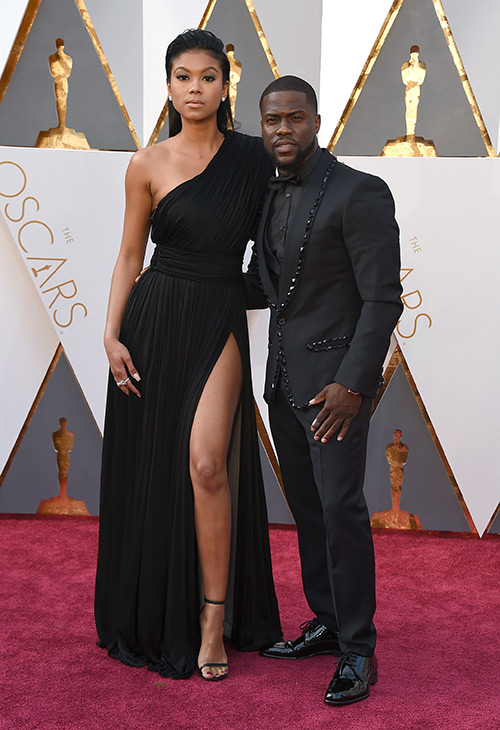 <div class='meta'><div class='origin-logo' data-origin='AP'></div><span class='caption-text' data-credit='Jordan Strauss/Invision/AP'>Eniko Parrish, left, and Kevin Hart arrive at the Oscars on Sunday, Feb. 28, 2016, at the Dolby Theatre in Los Angeles.</span></div>