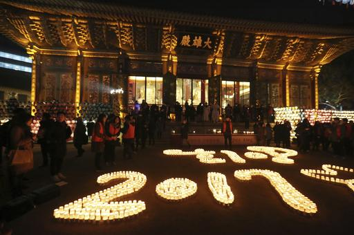 <div class='meta'><div class='origin-logo' data-origin='AP'></div><span class='caption-text' data-credit='AP Photo/Ahn Young-joon'>Buddhists light candles during New Year celebrations at Jogye Buddhist temple in Seoul, South Korea, early Sunday, Jan. 1, 2017.</span></div>