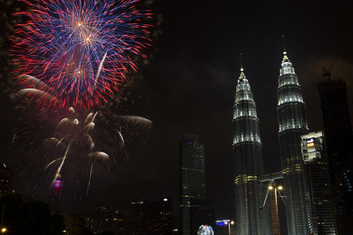 <div class='meta'><div class='origin-logo' data-origin='AP'></div><span class='caption-text' data-credit='AP Photo/Lim Huey Teng'>Fireworks explode in front of Malaysia's landmark building, Petronas Twin Towers, during the New Year's Eve celebration in Kuala Lumpur, Malaysia, early Sunday, Jan. 1, 2017.</span></div>