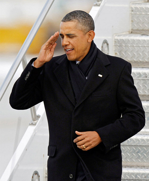"<div class=""meta image-caption""><div class=""origin-logo origin-image none""><span>none</span></div><span class=""caption-text"">The president gives a salute while exiting Air Force One in January 2012. (Mark Duncan / AP)</span></div>"