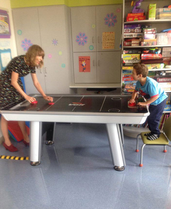 "<div class=""meta image-caption""><div class=""origin-logo origin-image ""><span></span></div><span class=""caption-text"">The country singer tries to hold her own against Jordan in air hockey. (Jordan's Brave Page / Facebook)</span></div>"