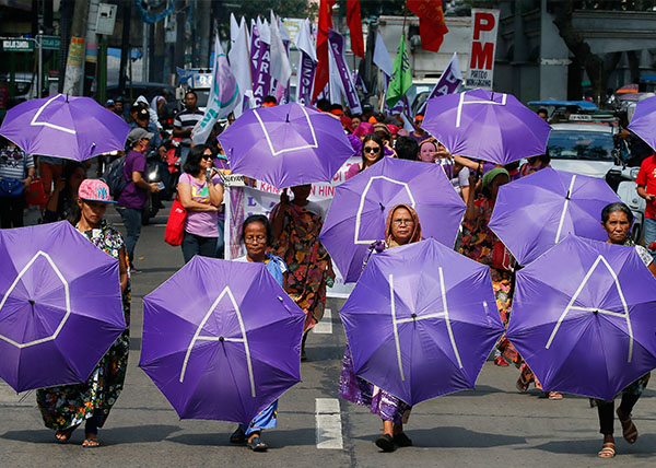 <div class='meta'><div class='origin-logo' data-origin='Creative Content'></div><span class='caption-text' data-credit='Bullit Marquez/AP'>Filipino women march towards a downtown park in for a rally to mark International Women's Day</span></div>