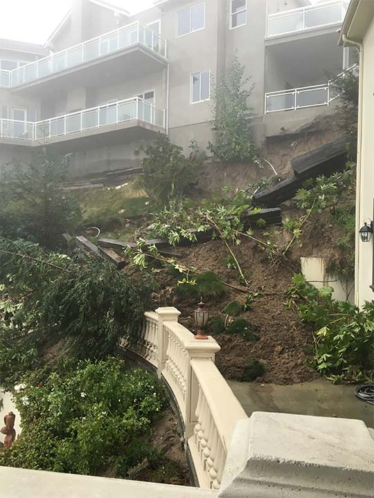 <div class='meta'><div class='origin-logo' data-origin='KABC'></div><span class='caption-text' data-credit=''>Rain-soaked earth gave way under a home in Pasadena, causing some retaining walls to tumble down a hillside on Wednesday, Jan. 6, 2016.</span></div>