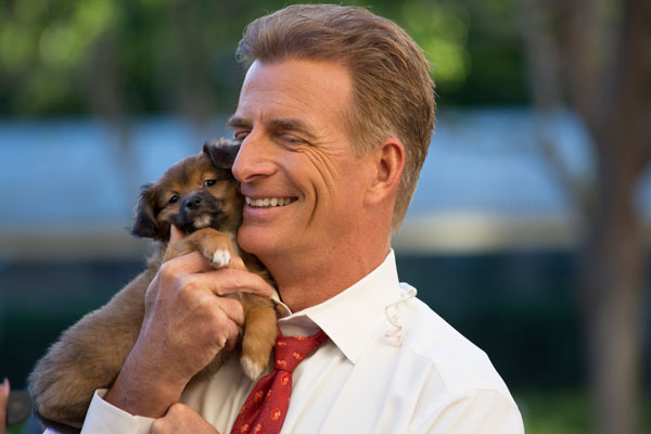 <div class='meta'><div class='origin-logo' data-origin='none'></div><span class='caption-text' data-credit='KABC'>Phillip Palmer can't help but cuddle with an adorable puppy.</span></div>
