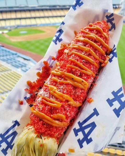 <div class='meta'><div class='origin-logo' data-origin='none'></div><span class='caption-text' data-credit='Twitter/@TanayasTable'>A Flamin' Hot Cheetos corn on the cob is shown at Dodger Stadium.</span></div>