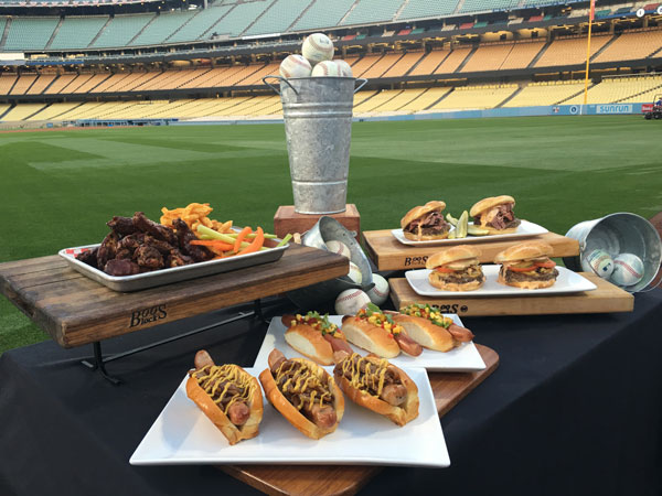 "<div class=""meta image-caption""><div class=""origin-logo origin-image none""><span>none</span></div><span class=""caption-text"">An array of food items ranging from gourmet burgers to Dodger Dogs and chicken wings are shown above. (KABC)</span></div>"