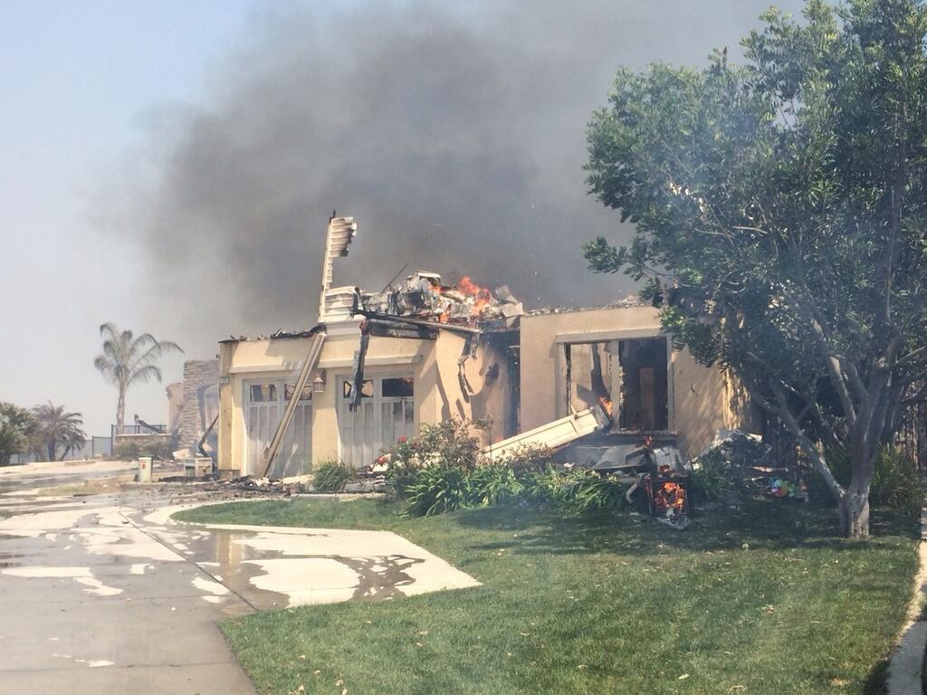 <div class='meta'><div class='origin-logo' data-origin='none'></div><span class='caption-text' data-credit='Rob McMillan'>One of at least 30 homes destroyed by fire in Carlsbad, Wednesday, May 14, 2014. Photo: Inland Empire Bureau Chief Rob McMillan</span></div>