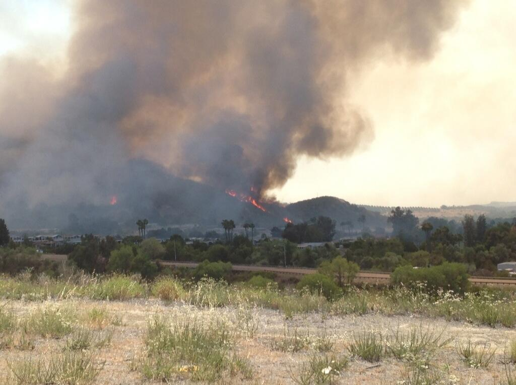 Inland Empire Bureau Chief Rob McMillan took this photo of flames climbing hills above homes near Camp Pendleton area, Wednesday, May 14, 2014. <span class=meta>(Rob McMillan)</span>