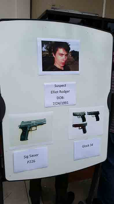 A board is seen showing the photos of suspected gunman Elliot Rodger and the weapons he used in Friday night's mass shooting that took place in Isla Vista, Calif. <span class=meta></span>
