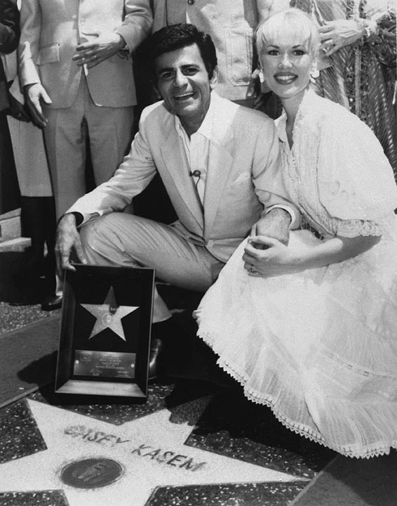 In this April 27, 1981 photo, Casey Kasem and his wife Jean smile as he receives his own