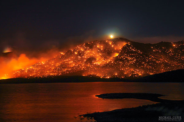 <div class='meta'><div class='origin-logo' data-origin='KABC'></div><span class='caption-text' data-credit='Michael Cuffe/@mikecuffe'>The moon rises over a burning hillside in the Kern River Valley during the Erskine Fire.</span></div>