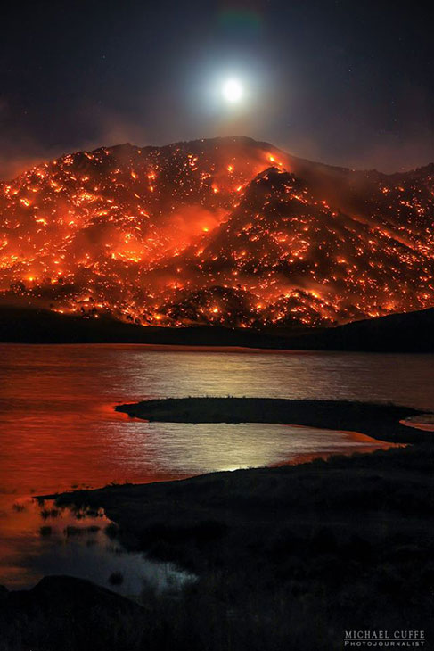 <div class='meta'><div class='origin-logo' data-origin='KABC'></div><span class='caption-text' data-credit='Michael Cuffe/@mikecuffe'>The moon rises over a hillside consumed by the Erskine Fire in the Kern River Valley.</span></div>