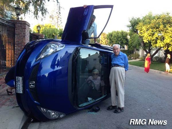 Benjamin and Elizabeth Neufeld's car somehow ended up on its side on Linda Flora Drive in Bel Air on Friday, June 20, 2014. <span class=meta></span>