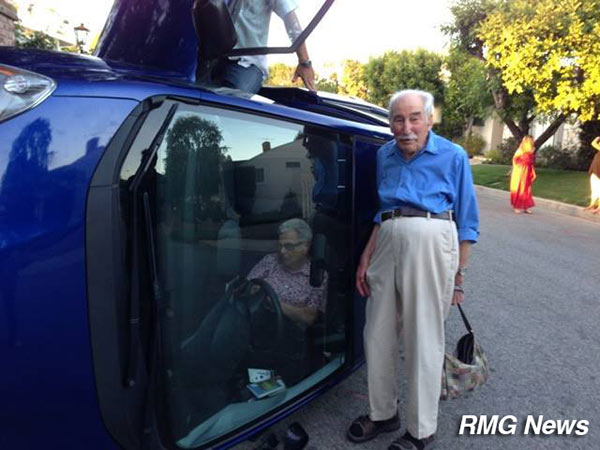 <div class='meta'><div class='origin-logo' data-origin='none'></div><span class='caption-text' data-credit=''>Benjamin and Elizabeth Neufeld's car somehow ended up on its side on Linda Flora Drive in Bel Air on Friday, June 20, 2014.</span></div>