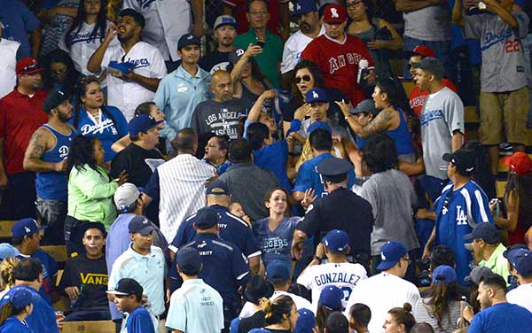 "<div class=""meta image-caption""><div class=""origin-logo origin-image none""><span>none</span></div><span class=""caption-text"">Fans in Dodger Stadium are seen gesturing as a brawl broke out in the stadium's outfield pavilion area on Monday, June 26, 2017. (Stephen Carr / Daily News / SCNG)</span></div>"