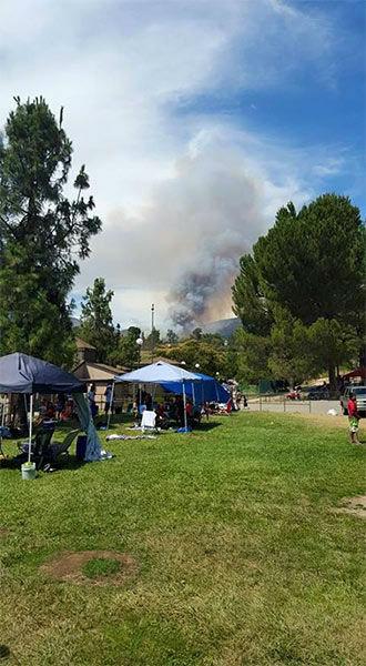"""<div class=""""meta image-caption""""><div class=""""origin-logo origin-image none""""><span>none</span></div><span class=""""caption-text"""">Smoke rises into the sky after a brush fire broke out in the San Bernardino National Forest on Sunday, July 12, 2015. (Rigo Guardado)</span></div>"""