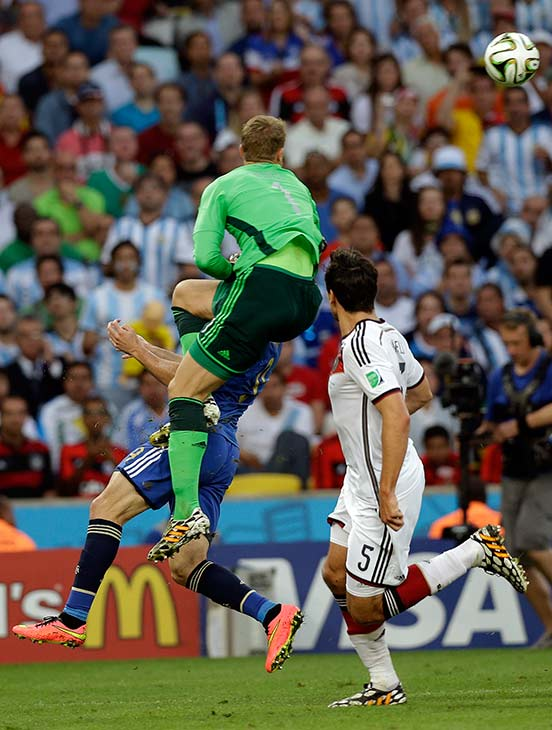 Germany&#39;s goalkeeper Manuel Neuer, top, collides with Argentina&#39;s Gonzalo Higuain, rear, during the World Cup final soccer match between Germany and Argentina. <span class=meta>(Victor R. Caivano)</span>