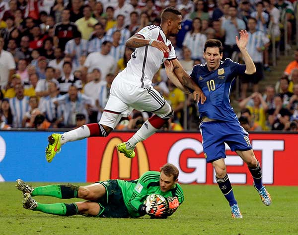 "<div class=""meta image-caption""><div class=""origin-logo origin-image ""><span></span></div><span class=""caption-text"">Germany's Jerome Boateng leaps over goalkeeper Manuel Neuer to block Argentina's Lionel Messi after Neuer's save on Messi during the World Cup final soccer match. (Natacha Pisarenko)</span></div>"