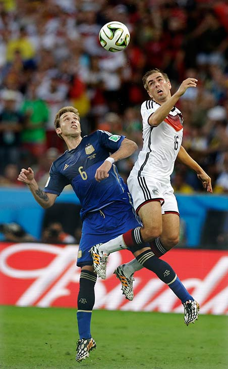 Argentina&#39;s Lucas Biglia, left, and Germany&#39;s Philipp Lahm go for a header during the World Cup final soccer match between Germany and Argentina. <span class=meta>(Victor R. Caivano)</span>