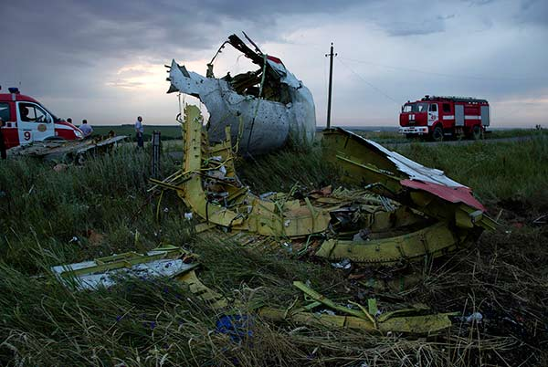 Fire engines arrive at the crash site of a passenger plane near the village of Grabovo, Ukraine, as the sun sets Thursday, July 17, 2014. <span class=meta>AP Photo/Dmitry Lovetsky</span>