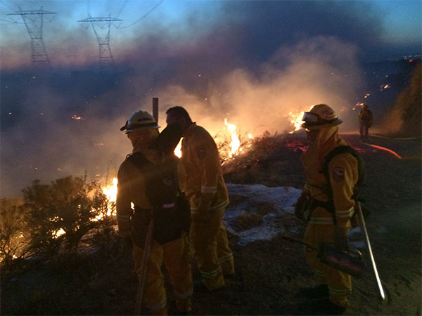 <div class='meta'><div class='origin-logo' data-origin='KABC'></div><span class='caption-text' data-credit='Martin Orozco'>Firefighters work to put out the North Fire, which reached 3,500 acres, on Friday, July 17, 2015.</span></div>