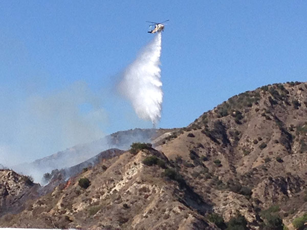 "<div class=""meta image-caption""><div class=""origin-logo origin-image kabc""><span>KABC</span></div><span class=""caption-text"">ABC7 viewer Alin Hughes sent in this photo of a helicopter dropping water on the North Fire on Friday, July 17, 2015. (Alin Hughes)</span></div>"