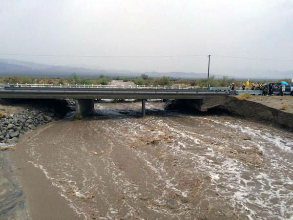 "<div class=""meta image-caption""><div class=""origin-logo origin-image none""><span>none</span></div><span class=""caption-text"">Flood waters run under a bridge over the 10 Freeway at Desert Center on Sunday, July 19, 2015. (Photo/John Hawkins)</span></div>"