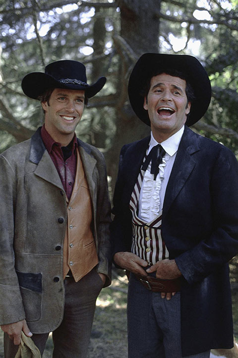 Actor James Garner, right, is shown in character for the TV series 'Young Maverick' with Frank Charles in November 1979. <span class=meta>AP Photo/Warner Bros.</span>