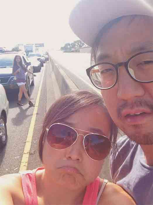 <div class='meta'><div class='origin-logo' data-origin='none'></div><span class='caption-text' data-credit='Sarah Jung'>Sarah Jung took a 'selfie' with a friend after they were left stranded in standstill traffic due to a man on an overpass above the 5 Freeway in East Los Angeles July 25, 2014.</span></div>