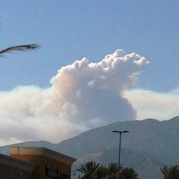 <div class='meta'><div class='origin-logo' data-origin='none'></div><span class='caption-text' data-credit='twitter.com/DJJesC'>ABC7 viewer @DJJesC sent in this photo of the Angeles National Forest brush fire from Upland on Sunday, Aug. 17, 2014.</span></div>
