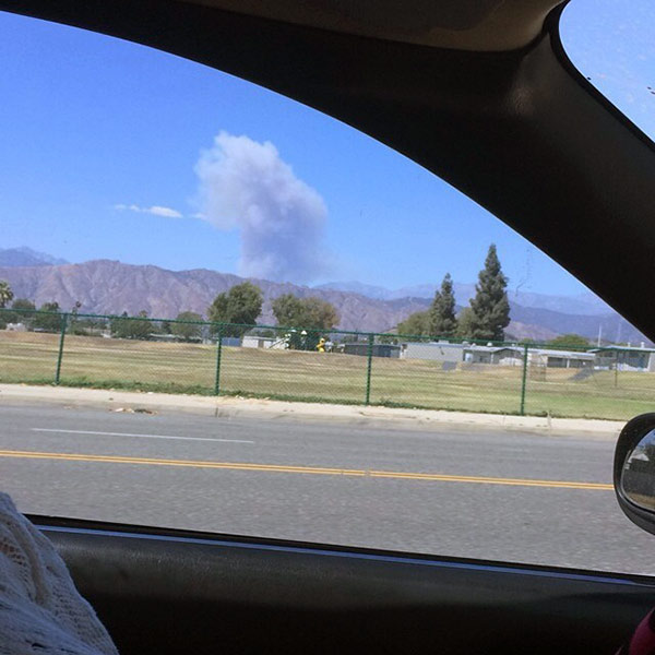 <div class='meta'><div class='origin-logo' data-origin='~ORIGIN~'></div><span class='caption-text' data-credit='Jessica Rene'>ABC7 viewer Jessica Rene sent in this photo of smoke seen from her car of a brush fire in Angeles National Forest on Sunday, Aug. 17, 2014.</span></div>