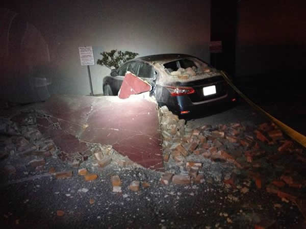 Bricks and fallen rubble cover a car after a 6.0-magnitude earthquake struck the northern San Francisco Bay Area Sunday, Aug. 24, 2014. <span class=meta>www.twitter.com/adreannababyyy</span>