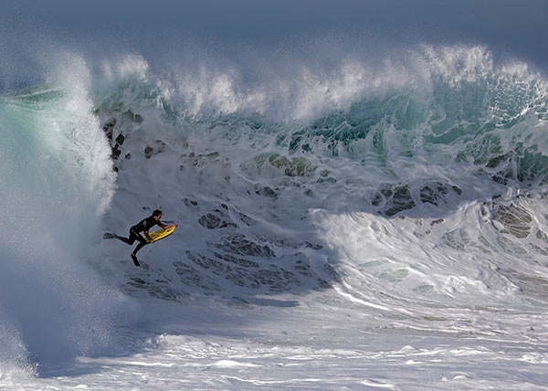 A bogieboarder rides a wave at the wedge in Newport Beach, Calif., Wednesday, Aug. 27, 2014. <span class=meta>AP Photo/Chris Carlson</span>